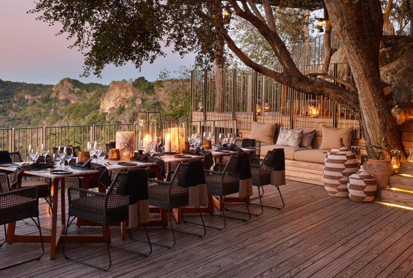 singita_pamushana_lodge_-_dinner_table_on_deck_overlooking_dam