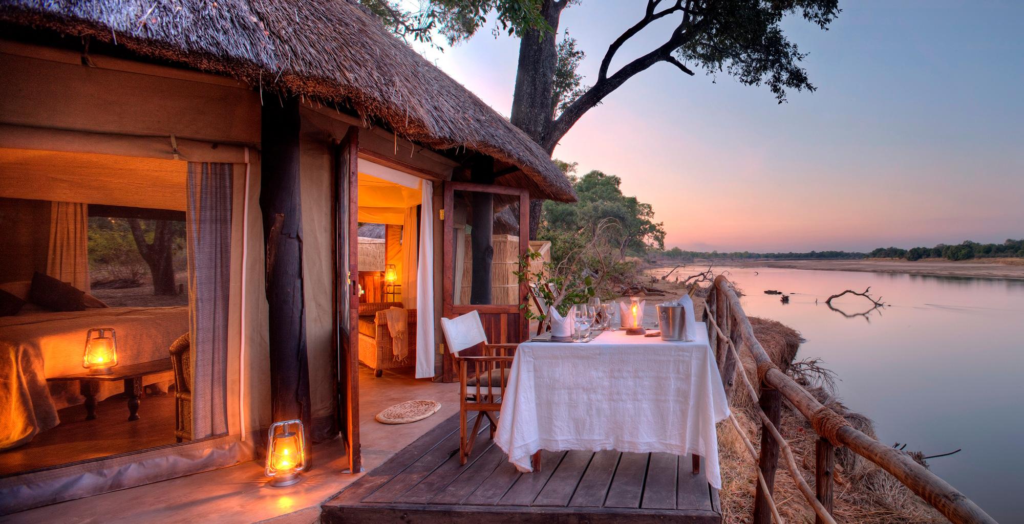 Zambia,-Mchenja-Camp,-Exterior-Sunset