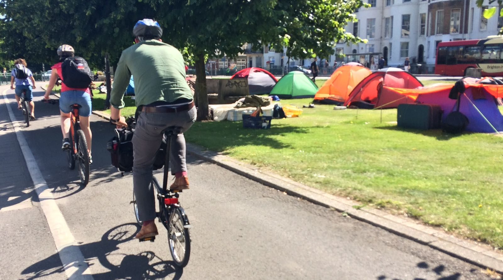 Journeys by Design team cycling through Brighton to the beach for a barbecue