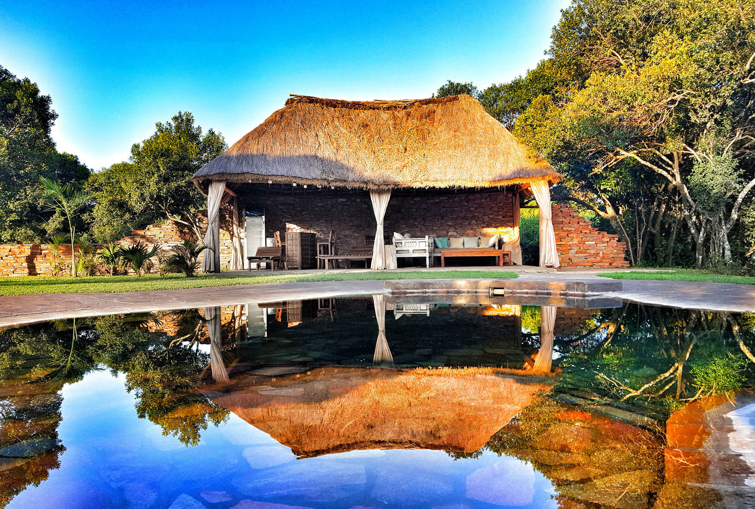 House-In-The-Wild-Exterior-Pond-Kenya